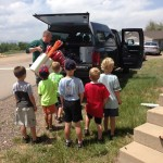 kids-watching-archery-equipment-being-laoded-into-truck